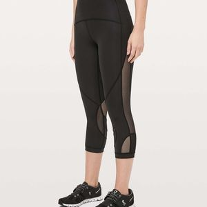 black lululemon asymmetrical crop leggings